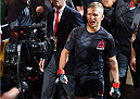 CHICAGO, IL - JULY 25:   TJ Dillashaw enters the arena before his UFC bantamweight championship bout against Renan Barao of Brazil during the UFC event at the United Center on July 25, 2015 in Chicago, Illinois. (Photo by Jeff Bottari/Zuffa LLC/Zuffa LLC via Getty Images)