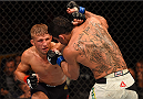 CHICAGO, IL - JULY 25:   (L-R) TJ Dillashaw punches Renan Barao of Brazil in their UFC bantamweight championship bout during the UFC event at the United Center on July 25, 2015 in Chicago, Illinois. (Photo by Jeff Bottari/Zuffa LLC/Zuffa LLC via Getty Images)
