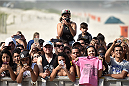 RIO DE JANEIRO, BRAZIL - JULY 29:  Brazilian fans watch an open training session at Pepe Beach on July 29, 2015 in Rio de Janeiro, Brazil.  (Photo by Buda Mendes/Zuffa LLC/Zuffa LLC via Getty Images)