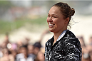 RIO DE JANEIRO, BRAZIL - JULY 29:  Womens bantamweight champion Ronda Rousey of the United States smiles during open training session at Pepe Beach on July 29, 2015 in Rio de Janeiro, Brazil.  (Photo by Buda Mendes/Zuffa LLC/Zuffa LLC via Getty Images)