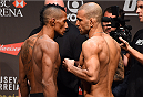 RIO DE JANEIRO, BRAZIL - JULY 31:  (L-R) Iuri Alcantara and Leandro Issa face off during the UFC 190 weigh-in inside HSBC Arena on July 31, 2015 in Rio de Janeiro, Brazil.  (Photo by Josh Hedges/Zuffa LLC/Zuffa LLC via Getty Images)