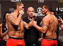 RIO DE JANEIRO, BRAZIL - JULY 31:  Antonio Silvaand Soa Palelei face off during the UFC 190 weigh-in inside HSBC Arena on July 31, 2015 in Rio de Janeiro, Brazil.  (Photo by Josh Hedges/Zuffa LLC/Zuffa LLC via Getty Images)