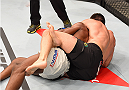 RIO DE JANEIRO, BRAZIL - AUGUST 01:  Demian Maia of Brazil (top) submits Neil Magny of the United States in their welterweight bout during the UFC 190 event inside HSBC Arena on August 1, 2015 in Rio de Janeiro, Brazil.  (Photo by Josh Hedges/Zuffa LLC/Zuffa LLC via Getty Images)