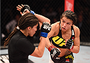 RIO DE JANEIRO, BRAZIL - AUGUST 01:  (R-L) Claudia Gadelha of Brazil punches Jessica Aguilar of the United States in their women's strawweight bout during the UFC 190 event inside HSBC Arena on August 1, 2015 in Rio de Janeiro, Brazil.  (Photo by Josh Hedges/Zuffa LLC/Zuffa LLC via Getty Images)