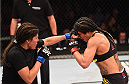 RIO DE JANEIRO, BRAZIL - AUGUST 01:  (L-R) Jessica Aguilar of the United States punches Claudia Gadelha of Brazil in their women's strawweight bout during the UFC 190 event inside HSBC Arena on August 1, 2015 in Rio de Janeiro, Brazil.  (Photo by Josh Hedges/Zuffa LLC/Zuffa LLC via Getty Images)