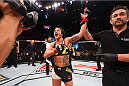 RIO DE JANEIRO, BRAZIL - AUGUST 01:  Claudia Gadelha of Brazil celebrates her victory over Jessica Aguilar of the United States in their women's strawweight bout during the UFC 190 event inside HSBC Arena on August 1, 2015 in Rio de Janeiro, Brazil.  (Photo by Josh Hedges/Zuffa LLC/Zuffa LLC via Getty Images)