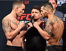 NASHVILLE, TN - AUGUST 07:  (L-R) Opponents Marlon Vera of Ecuador and Roman Salazar face off during the UFC weigh-in at Bridgestone Arena on August 7, 2015 in Nashville, Tennessee.  (Photo by Josh Hedges/Zuffa LLC/Zuffa LLC via Getty Images)