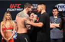 NASHVILLE, TN - AUGUST 07:  Chris Camozzi and Tom Watson of England face off during the UFC weigh-in at Bridgestone Arena on August 7, 2015 in Nashville, Tennessee.  (Photo by Josh Hedges/Zuffa LLC/Zuffa LLC via Getty Images)