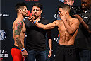 NASHVILLE, TN - AUGUST 07:  (L-R) Opponents Ray Borg and Geane Herrera face off during the UFC weigh-in at Bridgestone Arena on August 7, 2015 in Nashville, Tennessee.  (Photo by Josh Hedges/Zuffa LLC/Zuffa LLC via Getty Images)