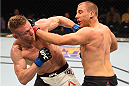 NASHVILLE, TN - AUGUST 08:  (L-R) Scott Holtzman punches Anthony Christodoulou of Greece in their lightweight bout during the UFC Fight Night event at Bridgestone Arena on August 8, 2015 in Nashville, Tennessee.  (Photo by Josh Hedges/Zuffa LLC/Zuffa LLC via Getty Images)