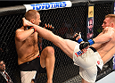 NASHVILLE, TN - AUGUST 08:  (R-L) Scott Holtzman kicks Anthony Christodoulou of Greece in their lightweight bout during the UFC Fight Night event at Bridgestone Arena on August 8, 2015 in Nashville, Tennessee.  (Photo by Josh Hedges/Zuffa LLC/Zuffa LLC via Getty Images)