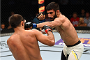 NASHVILLE, TN - AUGUST 08:  (R-L) Sirwan Kakai punches Frankie Saenz in their bantamweight bout during the UFC Fight Night event at Bridgestone Arena on August 8, 2015 in Nashville, Tennessee.  (Photo by Josh Hedges/Zuffa LLC/Zuffa LLC via Getty Images)