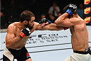 NASHVILLE, TN - AUGUST 08:  (L-R) Frankie Saenz punches Sirwan Kakai in their bantamweight bout during the UFC Fight Night event at Bridgestone Arena on August 8, 2015 in Nashville, Tennessee.  (Photo by Josh Hedges/Zuffa LLC/Zuffa LLC via Getty Images)