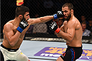 NASHVILLE, TN - AUGUST 08:  (L-R) Sirwan Kakai punches Frankie Saenz in their bantamweight bout during the UFC Fight Night event at Bridgestone Arena on August 8, 2015 in Nashville, Tennessee.  (Photo by Josh Hedges/Zuffa LLC/Zuffa LLC via Getty Images)