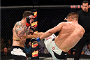 NASHVILLE, TN - AUGUST 08:  (R-L) Tom Watson of England lands a kick to the body of Chris Camozzi in their middleweight bout during the UFC Fight Night event at Bridgestone Arena on August 8, 2015 in Nashville, Tennessee.  (Photo by Josh Hedges/Zuffa LLC/Zuffa LLC via Getty Images)