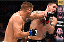 NASHVILLE, TN - AUGUST 08:  (L-R) Tom Watson of England punches Chris Camozzi in their middleweight bout during the UFC Fight Night event at Bridgestone Arena on August 8, 2015 in Nashville, Tennessee.  (Photo by Josh Hedges/Zuffa LLC/Zuffa LLC via Getty Images)
