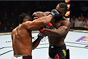 NASHVILLE, TN - AUGUST 08:  (L-R) Oluwale Bamgbose punches Uriah Hall of Jamaica in their middleweight bout during the UFC Fight Night event at Bridgestone Arena on August 8, 2015 in Nashville, Tennessee.  (Photo by Josh Hedges/Zuffa LLC/Zuffa LLC via Getty Images)