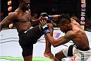 NASHVILLE, TN - AUGUST 08:  (L-R) Uriah Hall of Jamaica throws a knee at Oluwale Bamgbose in their middleweight bout during the UFC Fight Night event at Bridgestone Arena on August 8, 2015 in Nashville, Tennessee.  (Photo by Josh Hedges/Zuffa LLC/Zuffa LLC via Getty Images)