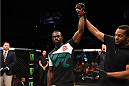 NASHVILLE, TN - AUGUST 08:  Uriah Hall of Jamaica celebrates after finishing Oluwale Bamgbose by TKO in their middleweight bout during the UFC Fight Night event at Bridgestone Arena on August 8, 2015 in Nashville, Tennessee.  (Photo by Josh Hedges/Zuffa LLC/Zuffa LLC via Getty Images)