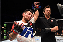 NASHVILLE, TN - AUGUST 08:  Ray Borg celebrates after defeating Geane Herrera in their flyweight bout during the UFC Fight Night event at Bridgestone Arena on August 8, 2015 in Nashville, Tennessee.  (Photo by Josh Hedges/Zuffa LLC/Zuffa LLC via Getty Images)
