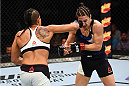 NASHVILLE, TN - AUGUST 08:  (L-R) Amanda Nunes of Brazil punches Sara McMann in their women's bantamweight bout during the UFC Fight Night event at Bridgestone Arena on August 8, 2015 in Nashville, Tennessee.  (Photo by Josh Hedges/Zuffa LLC/Zuffa LLC via Getty Images)