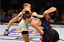 NASHVILLE, TN - AUGUST 08:  (L-R) Amanda Nunes of Brazil attempts a kick against Sara McMann in their women's bantamweight bout during the UFC Fight Night event at Bridgestone Arena on August 8, 2015 in Nashville, Tennessee.  (Photo by Josh Hedges/Zuffa LLC/Zuffa LLC via Getty Images)