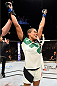 NASHVILLE, TN - AUGUST 08:  Amanda Nunes of Brazil celebrates after defeating Sara McMann in their women's bantamweight bout during the UFC Fight Night event at Bridgestone Arena on August 8, 2015 in Nashville, Tennessee.  (Photo by Josh Hedges/Zuffa LLC/Zuffa LLC via Getty Images)