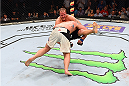 NASHVILLE, TN - AUGUST 08:  (L-R) Timothy Johnson takes down Jared Rosholt in their heavyweight bout during the UFC Fight Night event at Bridgestone Arena on August 8, 2015 in Nashville, Tennessee.  (Photo by Josh Hedges/Zuffa LLC/Zuffa LLC via Getty Images)