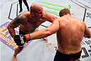 NASHVILLE, TN - AUGUST 08:  (L-R) Timothy Johnson punches Jared Rosholt in their heavyweight bout during the UFC Fight Night event at Bridgestone Arena on August 8, 2015 in Nashville, Tennessee.  (Photo by Josh Hedges/Zuffa LLC/Zuffa LLC via Getty Images)