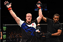 NASHVILLE, TN - AUGUST 08:  Jared Rosholt celebrates after defeating Timothy Johnson in their heavyweight bout during the UFC Fight Night event at Bridgestone Arena on August 8, 2015 in Nashville, Tennessee.  (Photo by Josh Hedges/Zuffa LLC/Zuffa LLC via Getty Images)