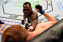 NASHVILLE, TN - AUGUST 08:  Derek Brunson (top) punches Sam Alvey in their middleweight bout during the UFC Fight Night event at Bridgestone Arena on August 8, 2015 in Nashville, Tennessee.  (Photo by Josh Hedges/Zuffa LLC/Zuffa LLC via Getty Images)