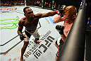 NASHVILLE, TN - AUGUST 08:  (L-R) Derek Brunson punches Sam Alvey in their middleweight bout during the UFC Fight Night event at Bridgestone Arena on August 8, 2015 in Nashville, Tennessee.  (Photo by Josh Hedges/Zuffa LLC/Zuffa LLC via Getty Images)
