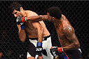 NASHVILLE, TN - AUGUST 08:  (R-L) Michael Johnson punches Beneil Dariush in their lightweight bout during the UFC Fight Night event at Bridgestone Arena on August 8, 2015 in Nashville, Tennessee.  (Photo by Josh Hedges/Zuffa LLC/Zuffa LLC via Getty Images)