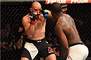NASHVILLE, TN - AUGUST 08:  (R-L) Ovince Saint Preux punches Glover Teixeira of Brazil in their light heavyweight bout during the UFC Fight Night event at Bridgestone Arena on August 8, 2015 in Nashville, Tennessee.  (Photo by Josh Hedges/Zuffa LLC/Zuffa LLC via Getty Images)