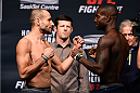 SASKATOON, SK - AUGUST 22:  (L-R) Opponents Chris Kelades of the United States and Chris Beal of the United States face off during the UFC weigh-in at the SaskTel Centre on August 22, 2015 in Saskatoon, Saskatchewan, Canada. (Photo by Jeff Bottari/Zuffa LLC/Zuffa LLC via Getty Images)