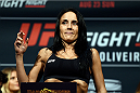 SASKATOON, SK - AUGUST 22:  Valerie Letourneau steps on the scale during the UFC weigh-in at the SaskTel Centre on August 22, 2015 in Saskatoon, Saskatchewan, Canada. (Photo by Jeff Bottari/Zuffa LLC/Zuffa LLC via Getty Images)