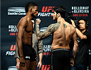SASKATOON, SK - AUGUST 22:  (L-R) Opponents Neil Magny of the United States and Erick Silva of Brazil face off during the UFC weigh-in at the SaskTel Centre on August 22, 2015 in Saskatoon, Saskatchewan, Canada. (Photo by Jeff Bottari/Zuffa LLC/Zuffa LLC via Getty Images)