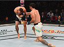 SASKATOON, SK - AUGUST 23:  (R-L) Elias Silverio of Brazil punches Shane Campbell in their lightweight bout during the UFC event at the SaskTel Centre on August 23, 2015 in Saskatoon, Saskatchewan, Canada. (Photo by Jeff Bottari/Zuffa LLC/Zuffa LLC via Getty Images)
