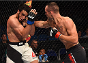SASKATOON, SK - AUGUST 23:  (R-L) Shane Campbell punches Elias Silverio of Brazil in their lightweight bout during the UFC event at the SaskTel Centre on August 23, 2015 in Saskatoon, Saskatchewan, Canada. (Photo by Jeff Bottari/Zuffa LLC/Zuffa LLC via Getty Images)
