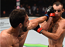 SASKATOON, SK - AUGUST 23:  (L-R) Elias Silverio of Brazil punches Shane Campbell in their lightweight bout during the UFC event at the SaskTel Centre on August 23, 2015 in Saskatoon, Saskatchewan, Canada. (Photo by Jeff Bottari/Zuffa LLC/Zuffa LLC via Getty Images)