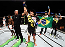 SASKATOON, SK - AUGUST 23:  Felipe Arantes of Brazil celebrates after his submission victory over Yves Jabouin in their bantamweight bout during the UFC event at the SaskTel Centre on August 23, 2015 in Saskatoon, Saskatchewan, Canada. (Photo by Jeff Bottari/Zuffa LLC/Zuffa LLC via Getty Images)