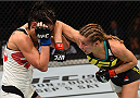 SASKATOON, SK - AUGUST 23:  (R-L) Maryna Moroz of Ukraine elbows Valerie Letourneau in their women's strawweight bout during the UFC event at the SaskTel Centre on August 23, 2015 in Saskatoon, Saskatchewan, Canada. (Photo by Jeff Bottari/Zuffa LLC/Zuffa LLC via Getty Images)
