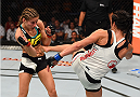 SASKATOON, SK - AUGUST 23:  (R-L) Valerie Letourneau kicks Maryna Moroz of Ukraine in their women's strawweight bout during the UFC event at the SaskTel Centre on August 23, 2015 in Saskatoon, Saskatchewan, Canada. (Photo by Jeff Bottari/Zuffa LLC/Zuffa LLC via Getty Images)
