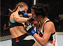 SASKATOON, SK - AUGUST 23:  (R-L) Valerie Letourneau punches Maryna Moroz of Ukraine in their women's strawweight bout during the UFC event at the SaskTel Centre on August 23, 2015 in Saskatoon, Saskatchewan, Canada. (Photo by Jeff Bottari/Zuffa LLC/Zuffa LLC via Getty Images)
