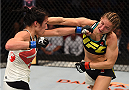 SASKATOON, SK - AUGUST 23:  (L-R) Valerie Letourneau punches Maryna Moroz of Ukraine in their women's strawweight bout during the UFC event at the SaskTel Centre on August 23, 2015 in Saskatoon, Saskatchewan, Canada. (Photo by Jeff Bottari/Zuffa LLC/Zuffa LLC via Getty Images)