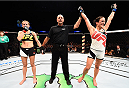 SASKATOON, SK - AUGUST 23:  Valerie Letourneau (R) celebrates after her unanimous-decision victory over Maryna Moroz of Ukraine in their women's strawweight bout during the UFC event at the SaskTel Centre on August 23, 2015 in Saskatoon, Saskatchewan, Canada. (Photo by Jeff Bottari/Zuffa LLC/Zuffa LLC via Getty Images)