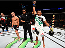 SASKATOON, SK - AUGUST 23:  Francisco Trinaldo (R) of Brazil celebrates after his TKO victory over Chad Laprise in their lightweight bout during the UFC event at the SaskTel Centre on August 23, 2015 in Saskatoon, Saskatchewan, Canada. (Photo by Jeff Bottari/Zuffa LLC/Zuffa LLC via Getty Images)