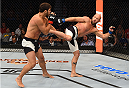 SASKATOON, SK - AUGUST 23:  (R-L) Josh Burkman of the United States kicks Patrick Cote in their welterweight bout during the UFC event at the SaskTel Centre on August 23, 2015 in Saskatoon, Saskatchewan, Canada. (Photo by Jeff Bottari/Zuffa LLC/Zuffa LLC via Getty Images)