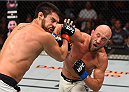 SASKATOON, SK - AUGUST 23:  (R-L) Josh Burkman of the United States punches Patrick Cote in their welterweight bout during the UFC event at the SaskTel Centre on August 23, 2015 in Saskatoon, Saskatchewan, Canada. (Photo by Jeff Bottari/Zuffa LLC/Zuffa LLC via Getty Images)