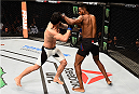 SASKATOON, SK - AUGUST 23:  (R-L) Neil Magny punches Erick Silva of Brazil in their welterweight bout during the UFC event at the SaskTel Centre on August 23, 2015 in Saskatoon, Saskatchewan, Canada. (Photo by Jeff Bottari/Zuffa LLC/Zuffa LLC via Getty Images)
